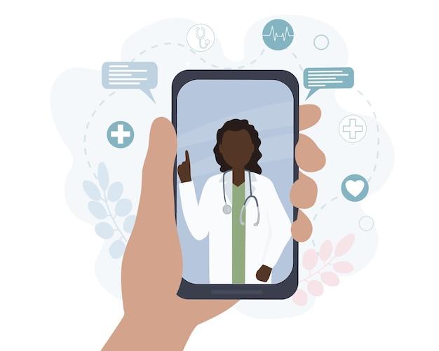 Uma médica negra americana fala com um paciente online
