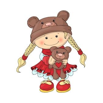 Uma menina bonitinha em um chapéu de urso de pelúcia em um vestido vermelho inteligente, com um ursinho de pelúcia nas mãos dela.