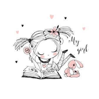 Uma menina bonitinha está lendo um livro.