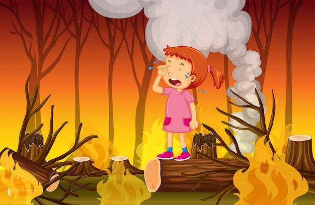 Uma menina chorando na floresta de incêndios