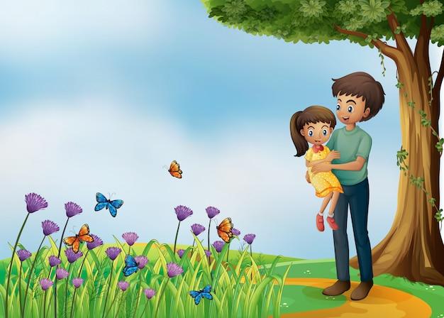 Uma menina e seu pai no topo da colina