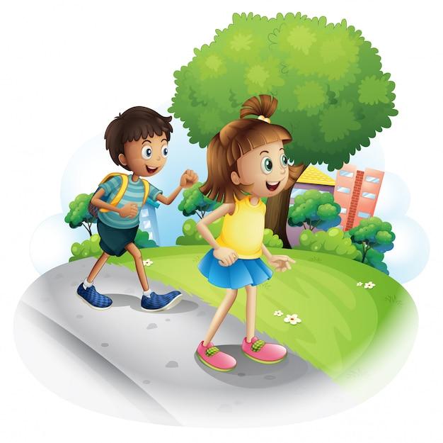 Uma menina e um menino andando pela rua