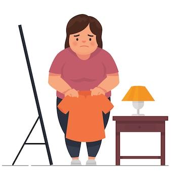 Uma menina gorda triste porque suas roupas eram muito pequenas