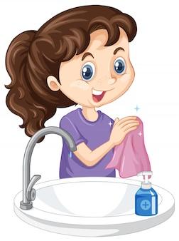 Uma menina que limpa as mãos