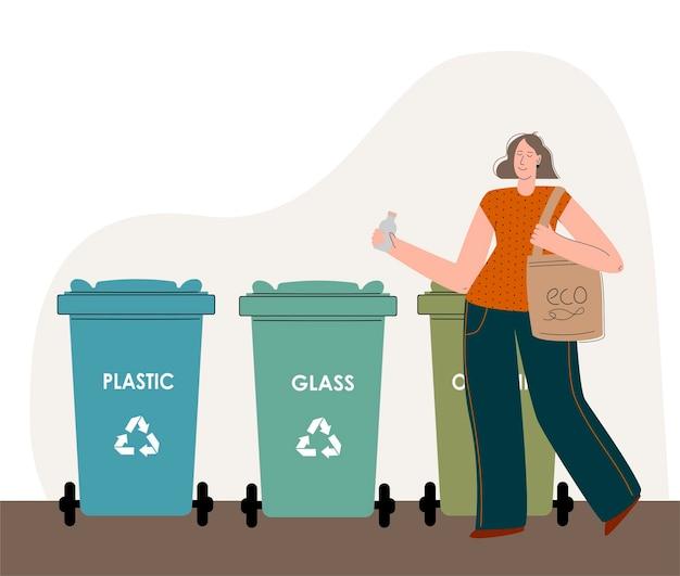 Uma menina que se preocupa com o meio ambiente separa o lixo e joga na lata de lixo para reciclagem ...