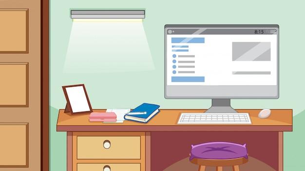 Uma mesa de computador na sala de estudo