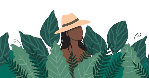 Uma mulher com um chapéu de palha parada em um matagal de grama alta