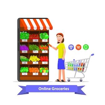 Uma mulher compra mantimentos por meio de um aplicativo online