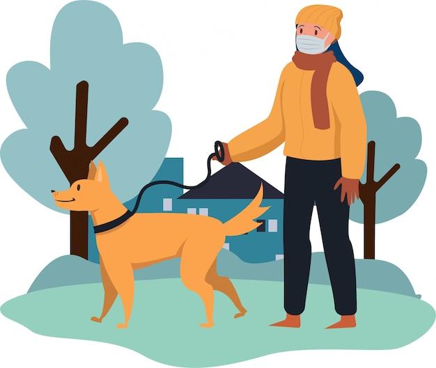 Uma mulher está andando lá fora com seu cachorro na temporada de inverno
