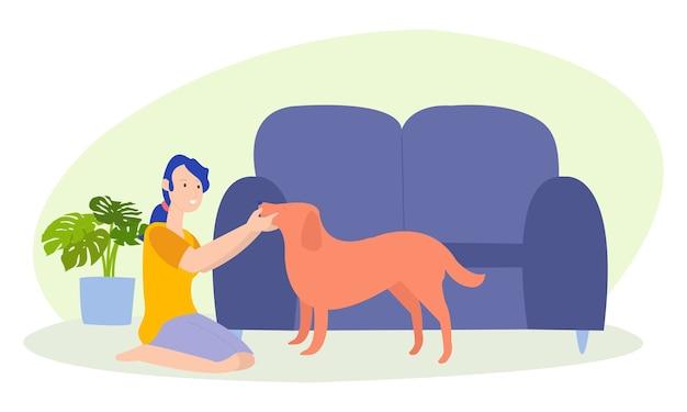 Uma mulher está brincando com um cachorro fofo na casa