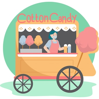 Uma mulher que vende algodão doce no vendedor de algodão doce enquanto continua usando máscara médica