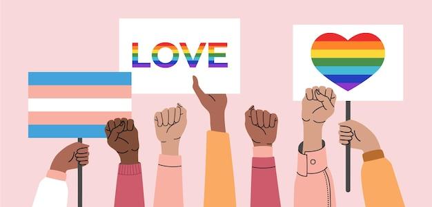 Uma multidão de pessoas segurando pôsteres lgbt, transgêneros e arco-íris em um desfile gay.