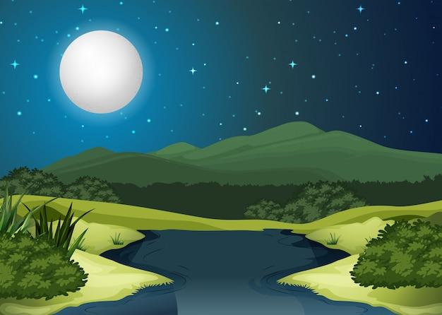 Uma paisagem do rio à noite