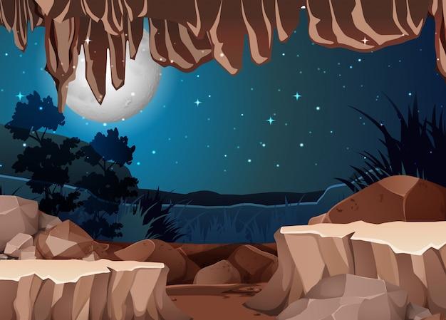 Uma paisagem vista da entrada da caverna