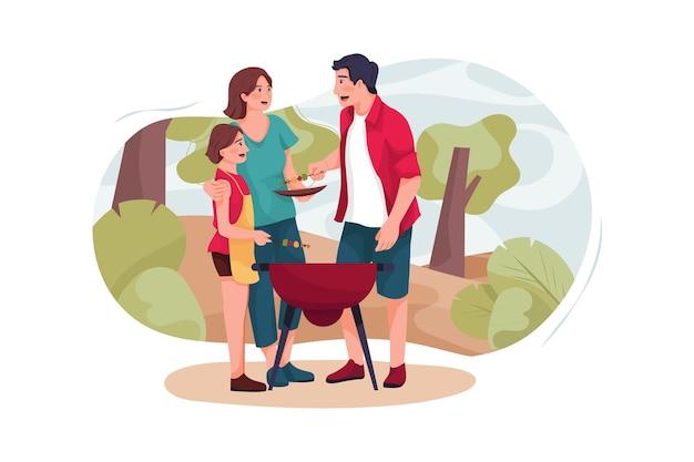 Uma pequena família faz um churrasco na floresta.