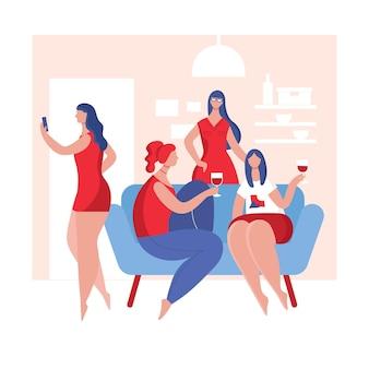 Uma reunião de mulheres jovens para se divertir e beber amigas sentadas no sofá