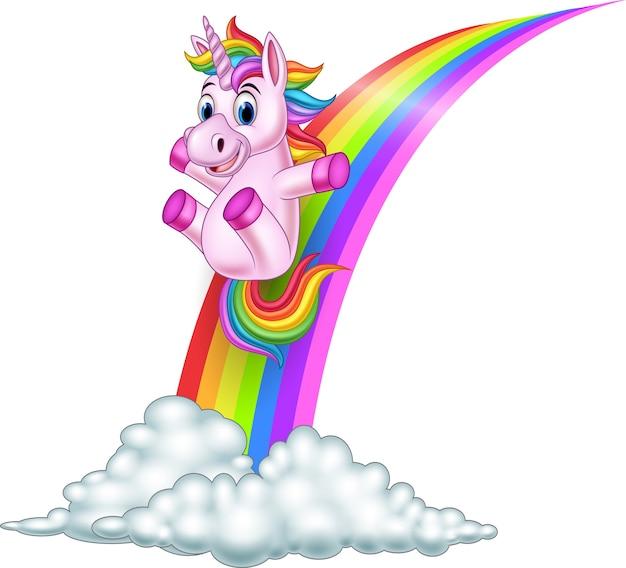 Unicórnio dos desenhos animados, deslizando sobre um arco-íris