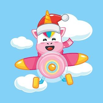 Unicórnio fofo com chapéu de papai noel voar com avião no dia de natal ilustração fofa dos desenhos animados de natal