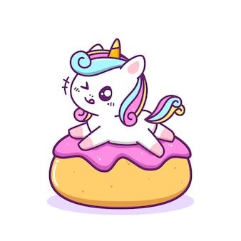 Unicórnio fofo e feliz brincando no donut