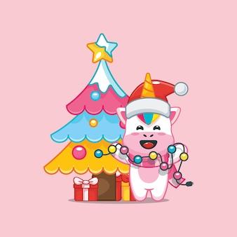 Unicórnio fofo no dia de natal segurando uma lâmpada de natal ilustração fofa dos desenhos animados de natal