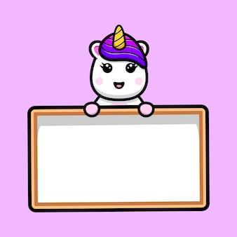 Unicórnio fofo segurando o desenho do mascote do quadro de texto em branco