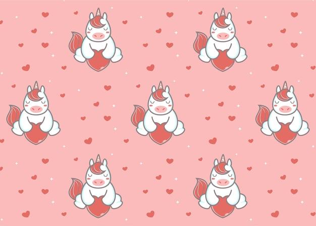 Unicórnio sentado com um padrão de balão do amor