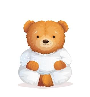 Ursinho de pelúcia sentado de pijama.