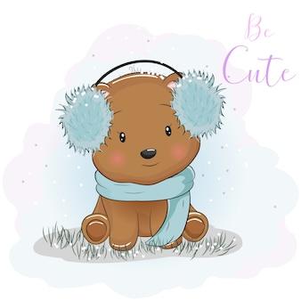 Urso bonito dos desenhos animados com fones de ouvido de pele e cachecol