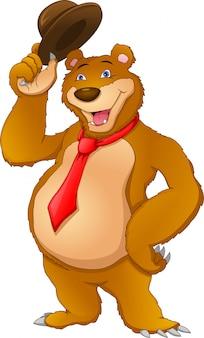 Urso bonito usando gravata e segurando o chapéu