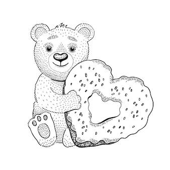 Urso brinquedo com donut de coração.