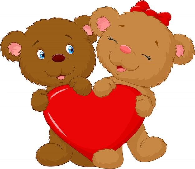 Urso casal segurando a forma de coração vermelho