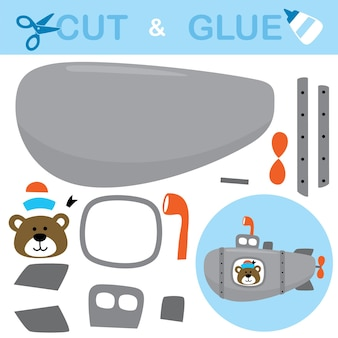 Urso com chapéu de marinheiro no submarino. jogo de papel para crianças. recorte e colagem.