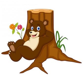 Urso de desenho animado, apoiando-se na madeira