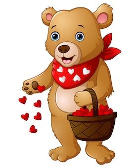 Urso de desenhos animados com uma cesta de coração vermelho