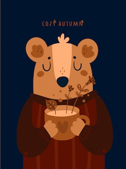 Urso de peluche bonito com o copo do chá erval. outono aconchegante