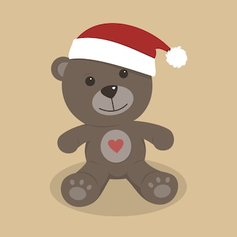 Urso de peluche do natal no fundo colorido
