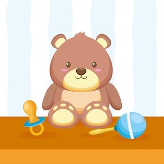 Urso de pelúcia, maraca e chupeta
