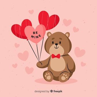 Urso de pelúcia segurando balões fundo dos namorados