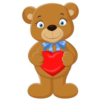 Urso engraçado de desenho animado segurando um coração