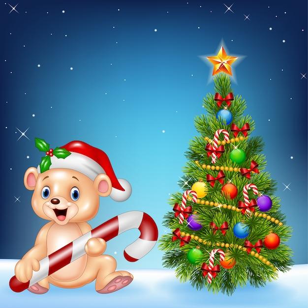 Urso feliz dos desenhos animados com árvore de natal