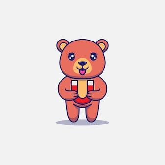 Urso fofo carregando um ímã