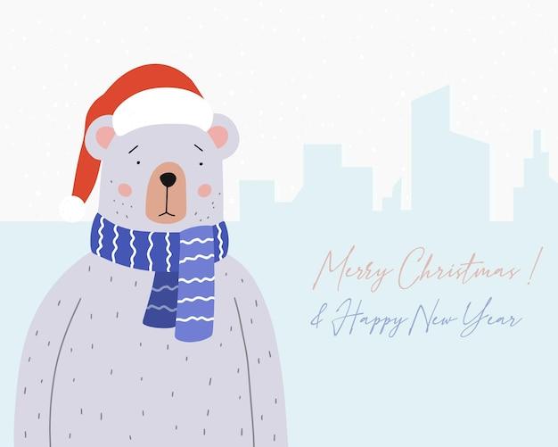 Urso fofo com um lenço azul e chapéu de papai noel