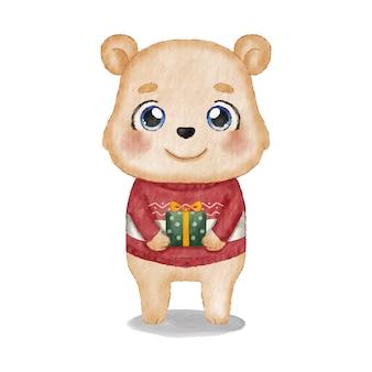 Urso fofo com um suéter feio de natal segurando um presente embrulhado