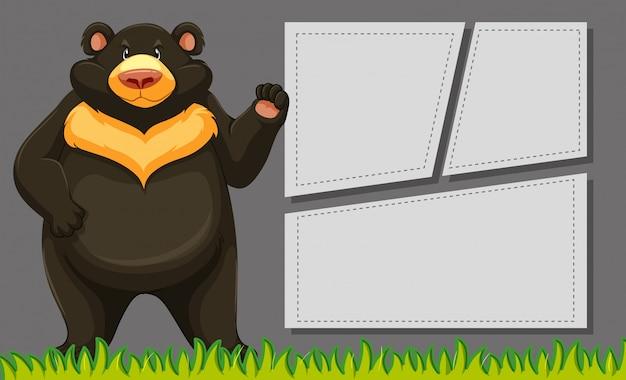 Urso no quadro de nota em branco