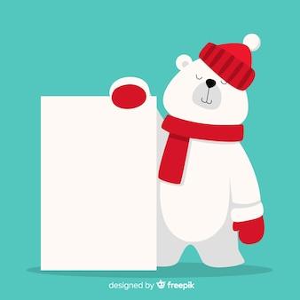 Urso polar plano segurando cartaz em branco
