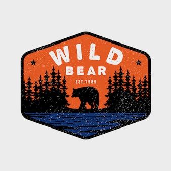 Urso selvagem aventura logotipo colorido vintage