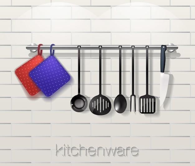 Utensílios de cozinha com utensílios de cozinha em um fundo de tijolo.