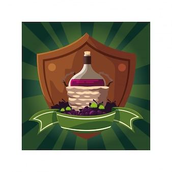 Uvas com ramo na cesta de vime no escudo com fita