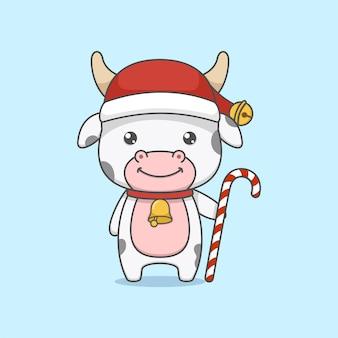 Vaca fofa de natal segurando um bastão de doces