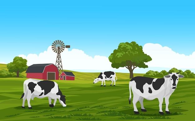 Vacas pastando em campo verde com casa de fazenda e moinho de vento